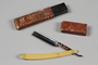 Straight razor with clear plastic handle