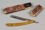 Straight razor with plastic tortoiseshell handle