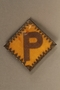 Forced labor badge worn by a Polish woman