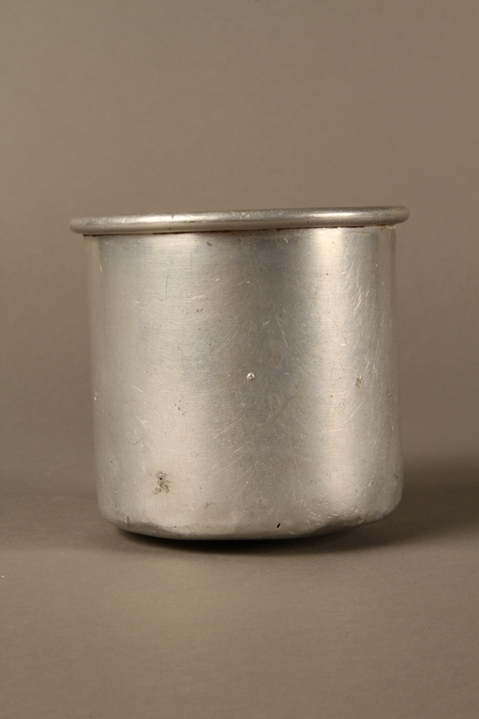 2017.309.1 front Tin mug issued to a Jewish girl and her family at a displaced persons camp