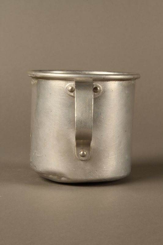 2017.309.1 back Tin mug issued to a Jewish girl and her family at a displaced persons camp