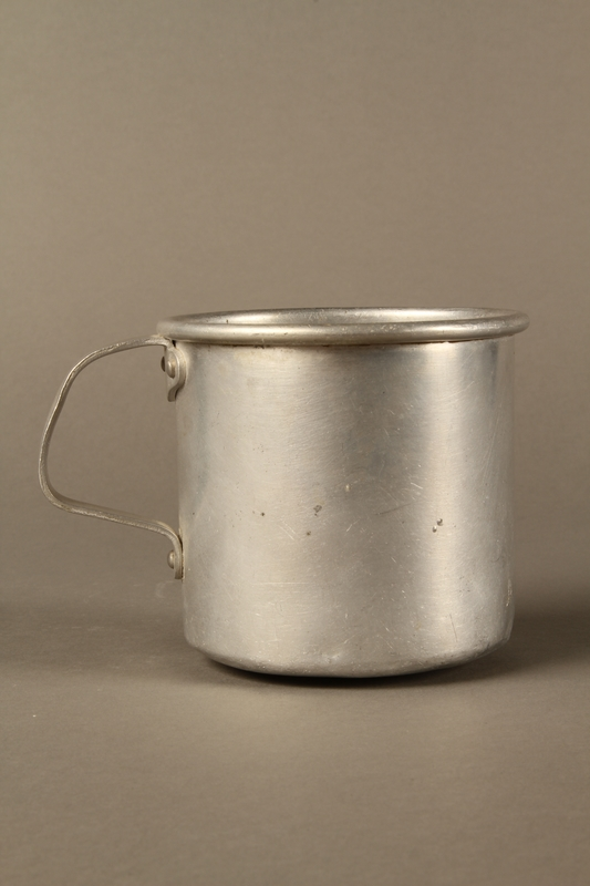 2017.309.1 right side Tin mug issued to a Jewish girl and her family at a displaced persons camp