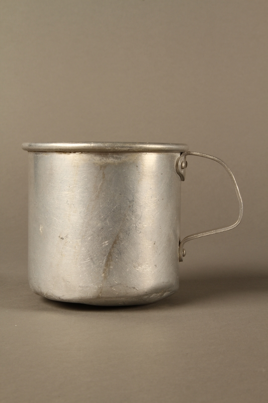 2017.309.1 left side Tin mug issued to a Jewish girl and her family at a displaced persons camp