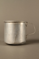 2017.309.1 left side Tin mug issued to a Jewish girl and her family at a displaced persons camp  Click to enlarge