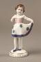 Porcelain figurine of a young girl in a white dress given to a Ukrainian Jewish family