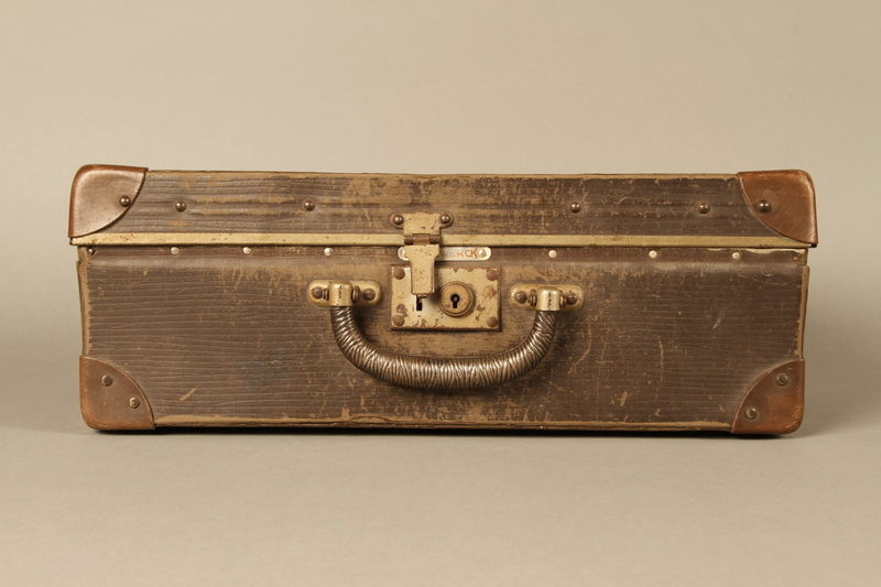 2017.541.5 front Small suitcase with a metal handle used by a Jewish Austrian physician