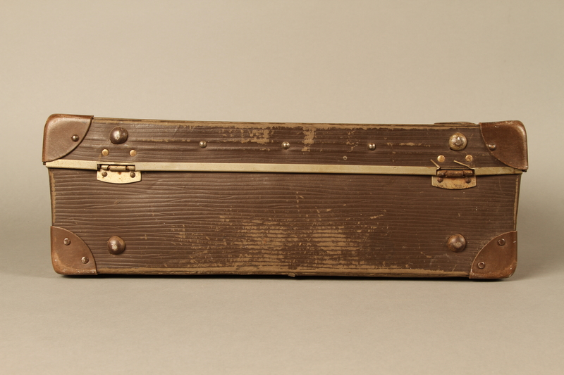 2017.541.5 back Small suitcase with a metal handle used by a Jewish Austrian physician