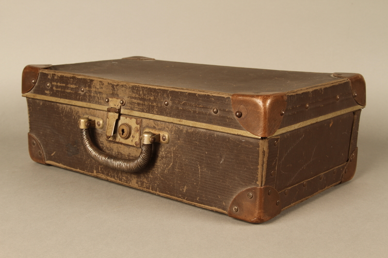 2017.541.5 3/4 view Small suitcase with a metal handle used by a Jewish Austrian physician