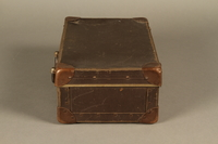 2017.541.5 left Small suitcase with a metal handle used by a Jewish Austrian physician  Click to enlarge