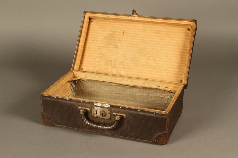 2017.541.5 open Small suitcase with a metal handle used by a Jewish Austrian physician