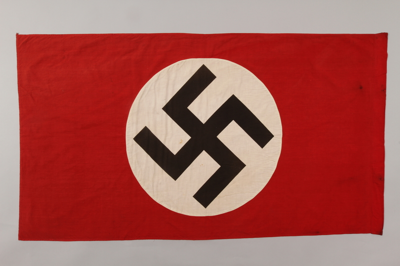 1992.104.1 front Nazi banner with a swastika on a white circle acquired by a US soldier