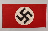 1992.104.1 front Nazi banner with a swastika on a white circle acquired by a US soldier  Click to enlarge