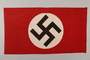 Nazi banner with a swastika on a white circle acquired by a US soldier
