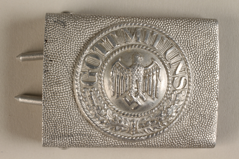 1992.104.3 front Belt buckle with an embossed Nazi Imperial eagle and motto acquired by a US soldier