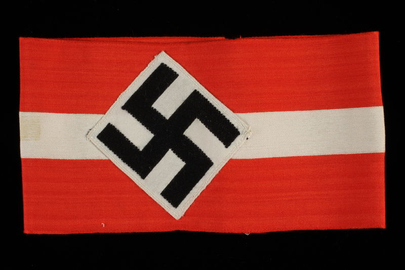1992.104.4 front Hitler Youth armband with a swastika acquired by a US soldier