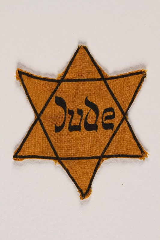 1992.109.1 front Star of David badge with Jude printed in the center
