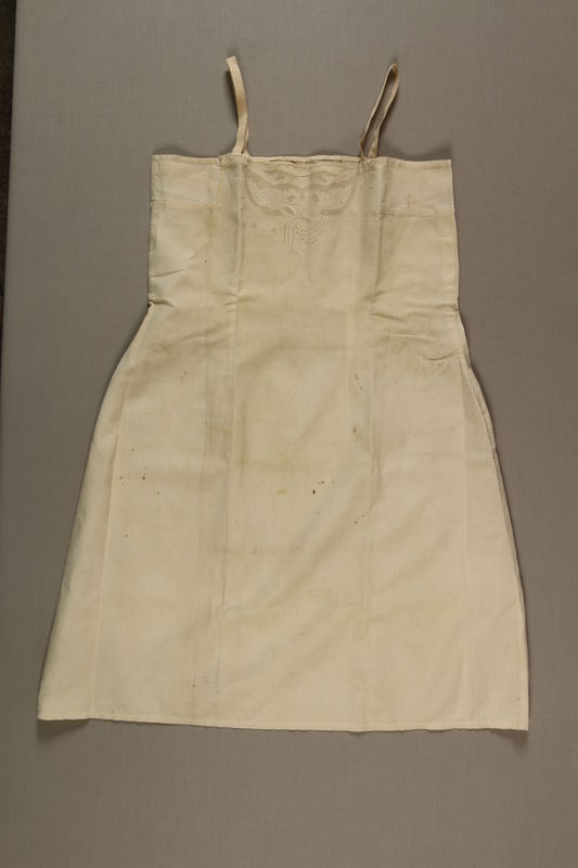 1992.115.1 front Slip worn by survivor of the Holocaust while in hiding
