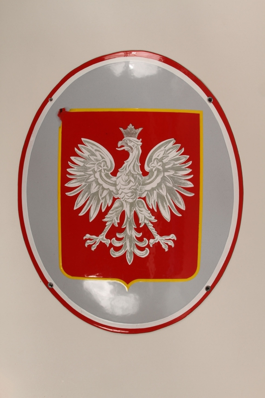 1992.119.1 front Red and silver enamel sign featuring the Polish Imperial eagle emblem
