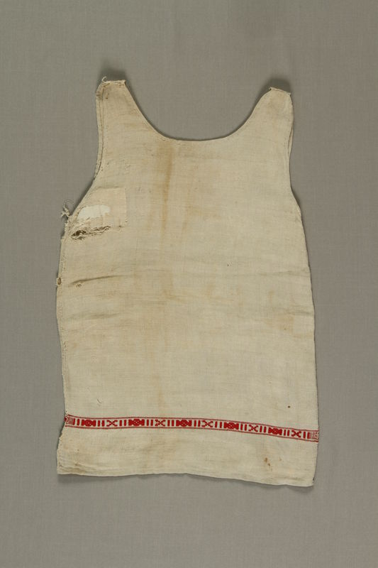 1992.121.1 front Dress worn by a young girl while living in hiding