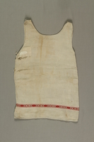 1992.121.1 front Dress worn by a young girl while living in hiding  Click to enlarge