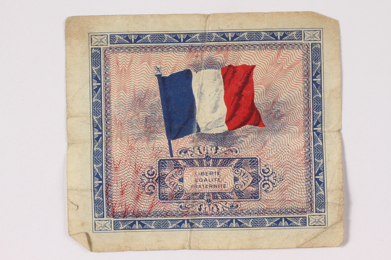 1992.122.10 back Allied Military Authority currency, 5 francs, for use in France, owned by a US soldier
