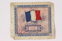 1992.122.10 back Allied Military Authority currency, 5 francs, for use in France, owned by a US soldier  Click to enlarge