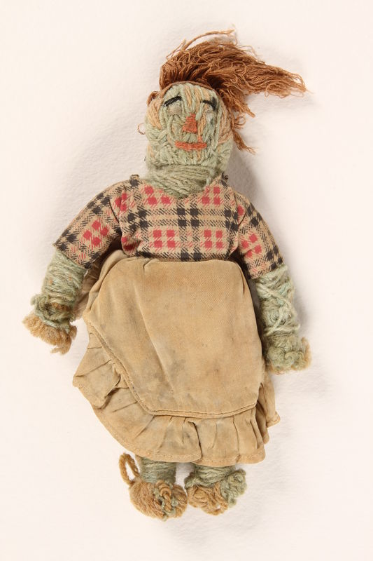 1992.122.1_a front Yarn doll, bag, and scrap of money found in a liberated camp by US soldier