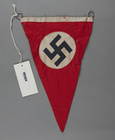 1992.122.3 front Red pennant with swastika found at a liberated concentration camp by a US soldier  Click to enlarge