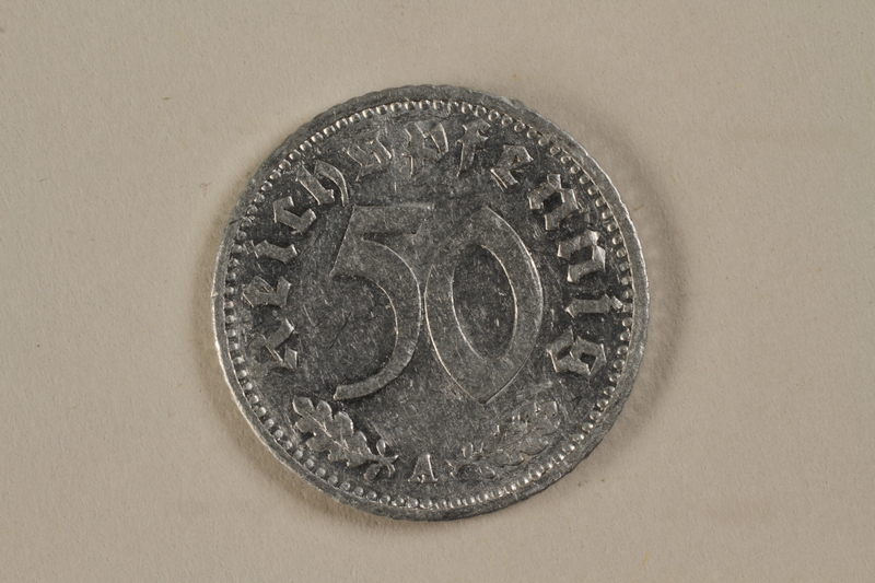 1992.122.4 front Nazi Germany, 50 reichspfennig coin found by an American soldier/liberator