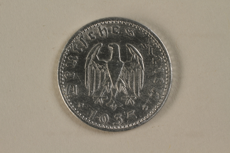 1992.122.4 back Nazi Germany, 50 reichspfennig coin found by an American soldier/liberator