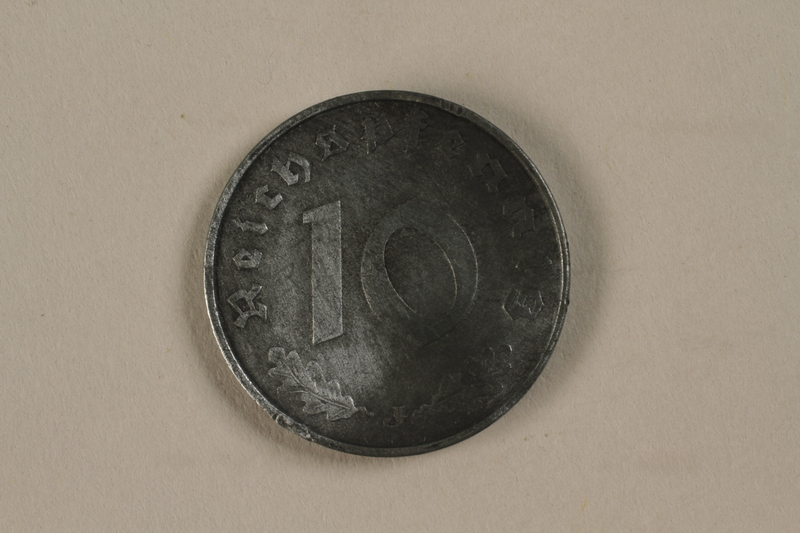 1992.122.7 front Nazi Germany, 10 reichspfennig coin found in a liberated camp by an American soldier
