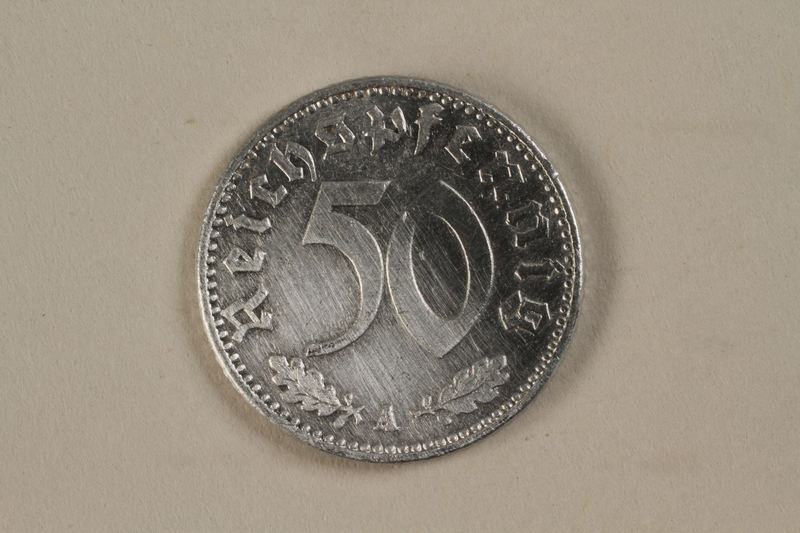 1992.122.8 front Nazi Germany, 50 reichspfennig coin found in a liberated camp by an American soldier