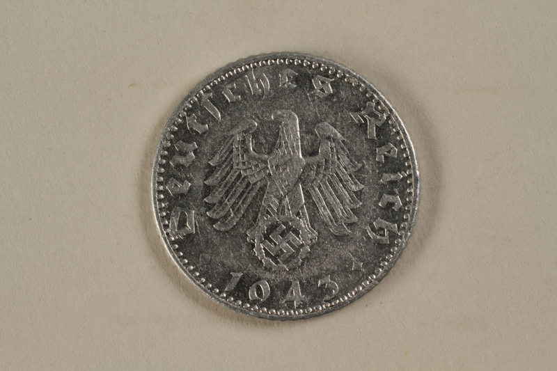 1992.122.8 back Nazi Germany, 50 reichspfennig coin found in a liberated camp by an American soldier