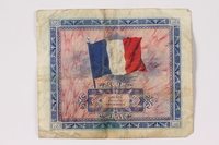 1992.122.9 back Allied Military Authority currency, 2 francs, for use in France, owned by a US soldier  Click to enlarge