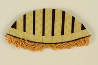1992.127.5 front Fringed epaulet with yellow swastikas and black stripes found by a US soldier  Click to enlarge