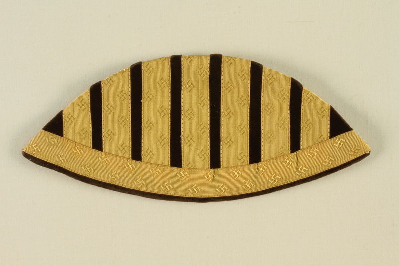 1992.127.7 front Epaulet with yellow swastikas and black stripes found by a US soldier