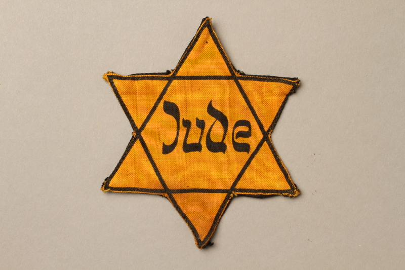 1992.132.2 front Star of David badge with Jude worn by a Jewish Czech woman