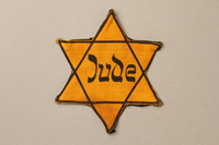 1992.132.2 front Star of David badge with Jude worn by a Jewish Czech woman  Click to enlarge