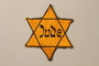 Star of David badge with Jude worn by a Jewish Czech woman