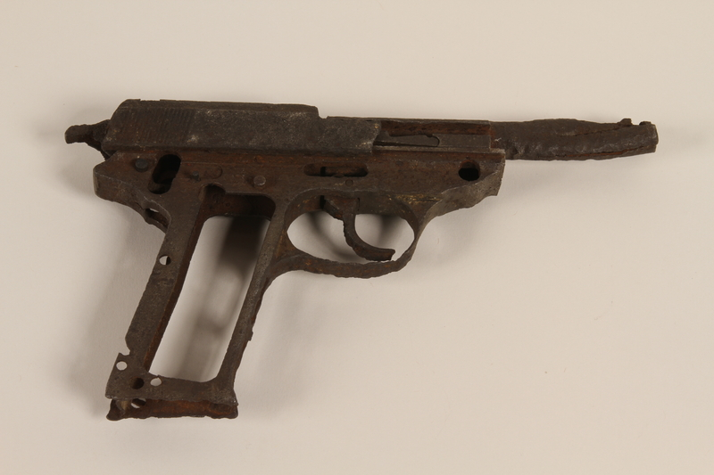 1992.134.4 front Mauser P38 pistol found buried in the Kampinos Forest near Warsaw