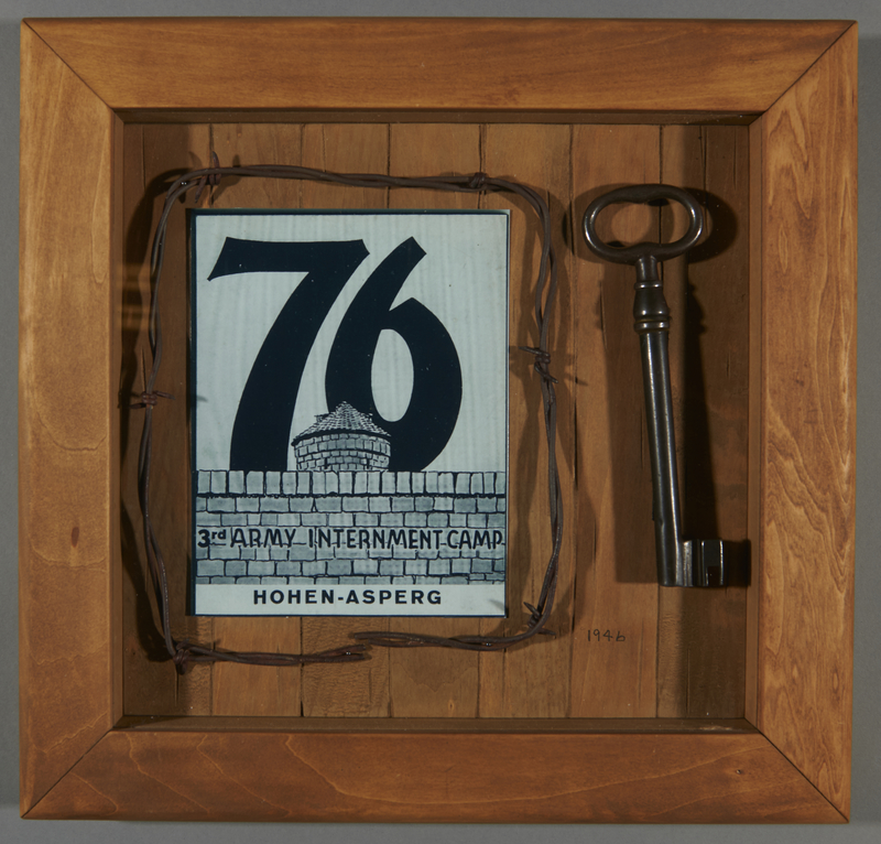 2017.632.1 front Barbed wire and a key in a shadowbox display belonging to a German-American internee