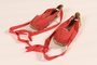 Pair of women's red espadrilles owned by a participant of the Emergency Rescue Committee