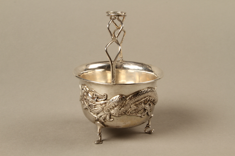 2017.513.6 left Silver bowl with a dragon owned by a Lithuanian Jewish refugee in the Shanghai Ghetto