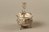 2017.513.6 left Silver bowl with a dragon owned by a Lithuanian Jewish refugee in the Shanghai Ghetto  Click to enlarge