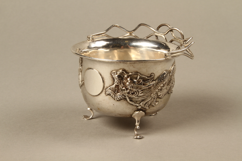 2017.513.6 3/4 view handle down Silver bowl with a dragon owned by a Lithuanian Jewish refugee in the Shanghai Ghetto