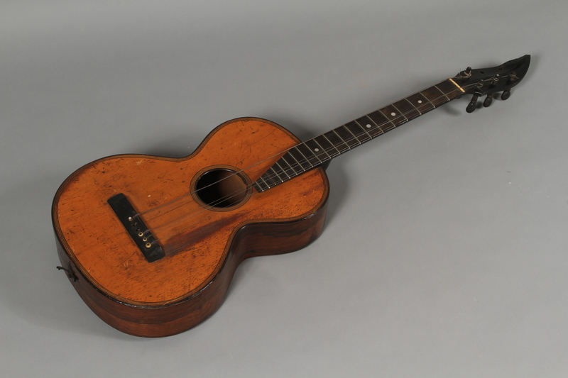1992.160.11 a front Accoustic guitar and bag