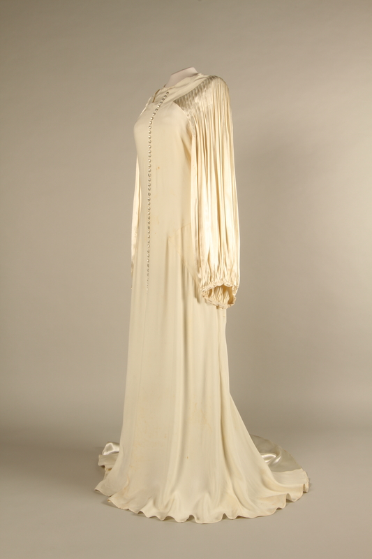 2018.58.2 3/4 left Wedding dress shipped to the United States by a German Jewish woman murdered at Riga