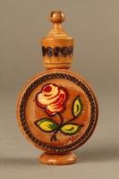 2017.609.2_a-b front Wooden perfume bottle holder with recessed designs owned by a Yugoslavian family  Click to enlarge
