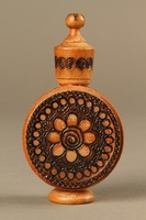 2017.609.2_a-b back Wooden perfume bottle holder with recessed designs owned by a Yugoslavian family  Click to enlarge