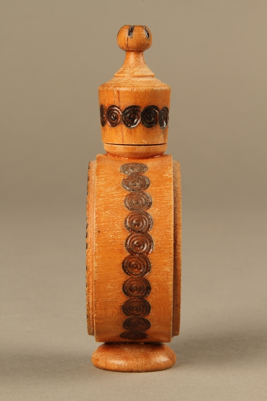 2017.609.2_a-b right side Wooden perfume bottle holder with recessed designs owned by a Yugoslavian family